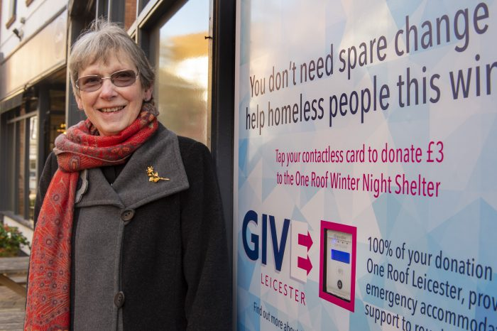 Alison Adams of Leicester Homelessness Charter next to a Give Leicester donation point at St Martins Coffee House